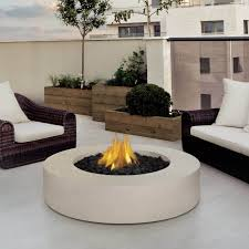 fireplace alternative decor features white rounded fire pit table