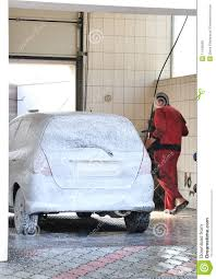 car wash service washerman washing car at car wash service royalty free stock