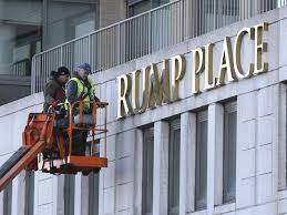 workers remove trump name from three nyc apartment buildings ny