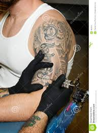 arm of man getting tattooed stock photo image 7852812