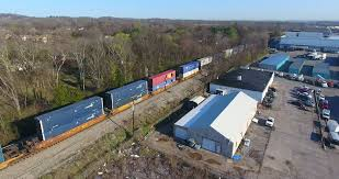 box car train 4k aerial freight train box cars flyover nashville tennessee