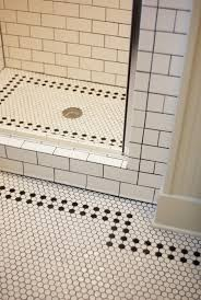 perfect white bathroom with black and white mosaic tiles flooring