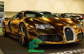 bugatti gold and gold chrome wrapped bugatti veyron owned by flo rida looks grotesque