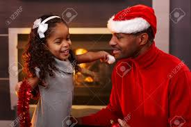 Christmas Decorations At Home Ethnic Father In Santa Hat Little Daughter With Christmas