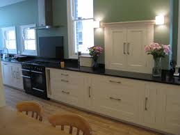 Long Galley Kitchen Ideas Long White Wooden Kitchen Cabinet With Black Countertop On