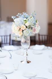 emlily floral tall wedding centerpiece with peach and blue