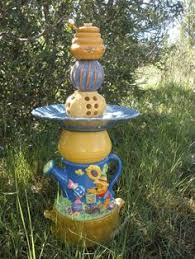 disney in cheshire cat garden statue disney store