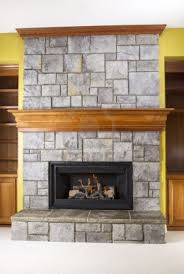 Stone Fireplace Mantel Shelf Designs by Stacked Stone With Wraparound Mantle And Crown Molding Fireplace
