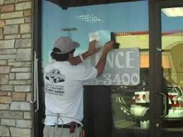 the best sign company vinyl lettering installation on marquee and