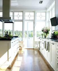kitchen with white cabinets and dark countertops white kitchen