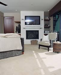 bedroom manly bedroom with arm chairs and dark wood nightstands manly bedroom with gas fireplace and wall mounted