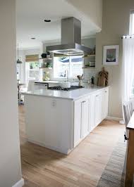 white kitchen cabinets wood floors our semi budget friendly white kitchen remodel kitchen