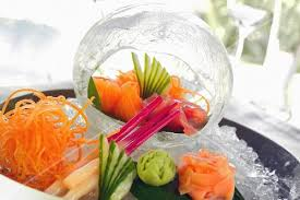 cuisine decorative sashimi on a serving platter and within a decorative cube