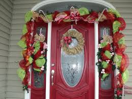 white wooden door decor with wreath and greenery