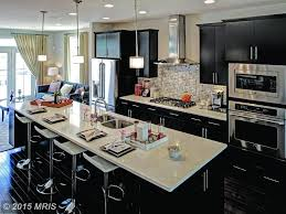 contemporary kitchen with breakfast bar u0026 complex marble counters