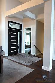 contemporary modern front door painted black with beams and high