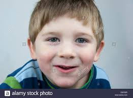 5 year boy up excited expression stock photo