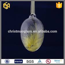 yellow feather inside empty glass egg ornaments clear buy glass