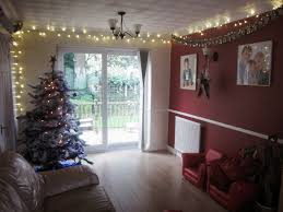 wall christmas lights decorations living room hanging christmas lights in room ideas net and how to