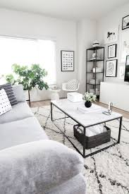coffee table styling monochrome west elm rug and grey couches