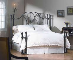 Rod Iron Canopy Bed by White Wooden Canopy Bed With Four Poles Also Curving Head Board