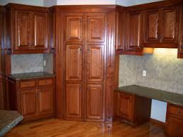 high brown wooden corner kitchen cabinet connected with storage