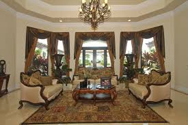 living rooms metal chandelier brown curtain window treatment