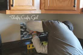 How To Install A Mosaic Tile Backsplash In The Kitchen by Thrifty Crafty Easy Kitchen Backsplash With Smart Tiles