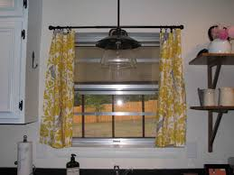 kitchen window designed with stained glass and using curtains