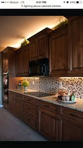 kitchen cabinets adding lights above and below the cabinets diy