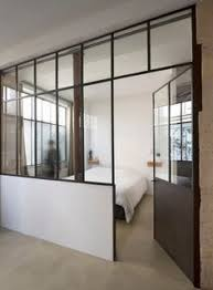 walls or extremely tall room divider with dark material to block