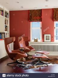 A Study With Walls In by Pair Of Red Leather Lounge Chairs From Moroso In Study With Red