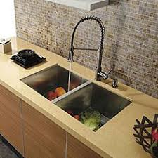 industrial kitchen faucets stainless steel stainless steel kitchen with viking refrigerator alongside