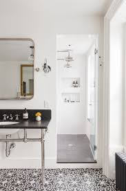 scandinavian bathroom designs with black slate floor and subway