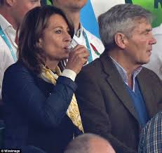 michael middleton carole middleton necks mini bottle of wine at the rugby world cup