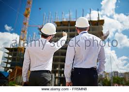 building construction team planning new house with floorplan stock