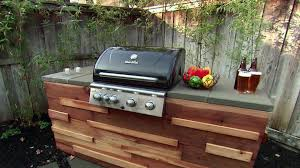 build a barbecue grill island from redwood posts and paver topped