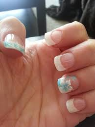 white french tip nail art with acrylic flower design