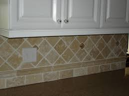 outlet cover painted to match backsplash tiles around the