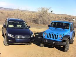 volkswagen jeep 2013 2012 volkswagen tiguan vs jeep wrangler 0 60 off road mashup
