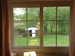 decorating charming sliding window with brown frame by reliabilt