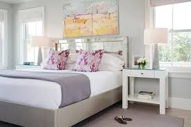 mirrored headboard with pink and purple pillows transitional
