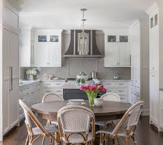 what color backsplash with white kitchen cabinets classic white kitchen with grey backsplash home bunch