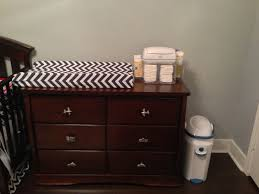 Brown Changing Table Brown Patterned Pad Changing Table Topper On Brown Wooden