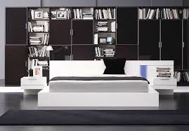 trendy bedroom with huge wall bookcase behind king size bed and