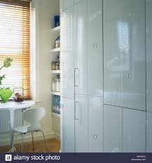 Kitchen Table Close Up Close Up Of White Melamine Fitted Cupboard In Modern Kitchen With