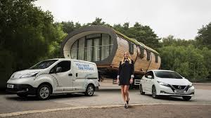 nissan green margot robbie promotes leaf u0027s green sets electric van tow record
