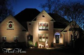 christmas spotlights decorating the outside for christmas all things heart and home