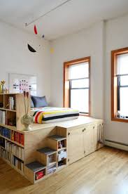 288 best kids stuff images on pinterest bedroom ideas boy insane platform bed with storage for inevitable tiny apartment living danny joni s brooklyn loft