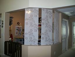 decor craft room design with dog gate and half wall room divider